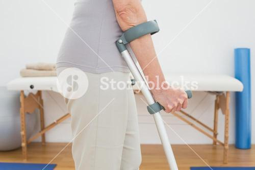 Closeup mid section of a woman with crutches