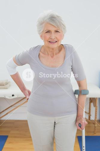 Portrait of a senior woman with crutch