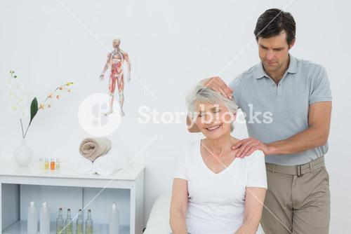 Senior woman getting the neck adjustment done