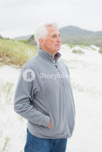 Contemplative casual senior man at beach