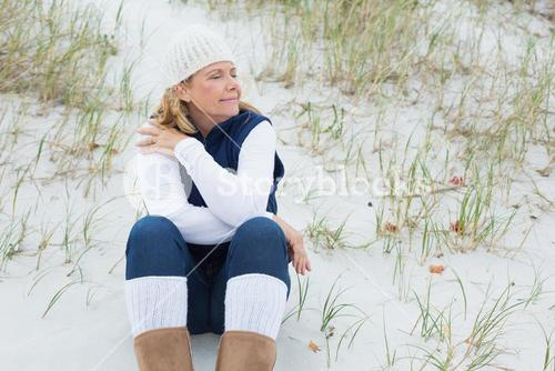 Senior woman with eyes closed at beach