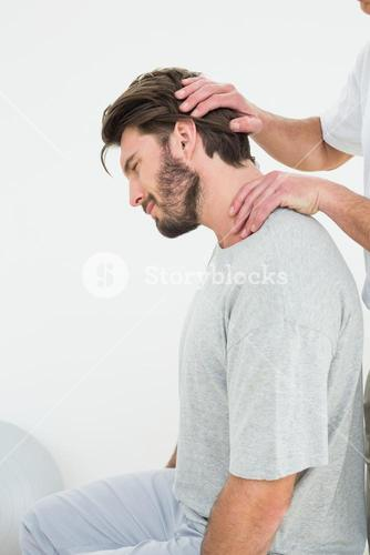 Side view of a man getting the neck adjustment done
