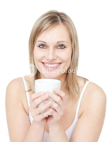 Portrait of a blond woman drinking cofee against a white background
