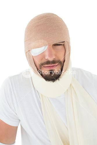 Closeup portrait of a man with head tied up in bandage