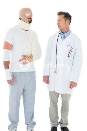 Doctor looking at a patient tied up in bandage