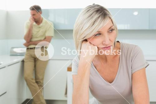 Angry couple after a fight in kitchen
