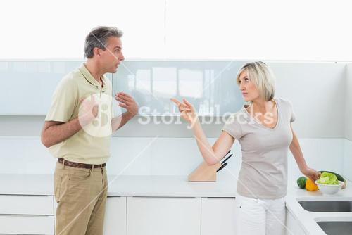 Angry couple arguing in the kitchen