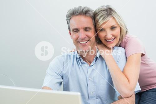 Concentrated content couple using laptop