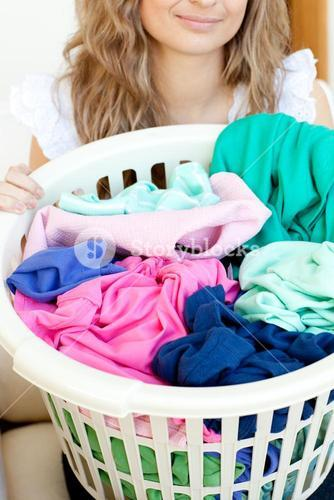 Close up of a young woman doing laundry