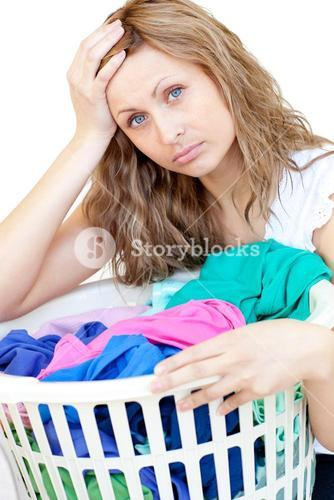 Tired woman doing laundry