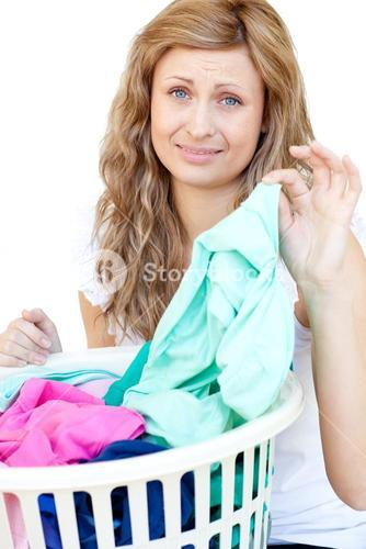 Upset woman doing laundry