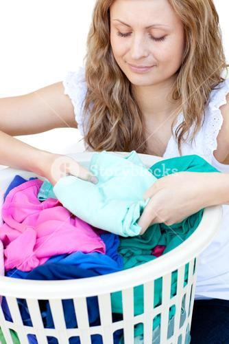 Attractive woman doing laundry