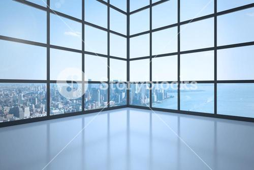 Room with window showing city