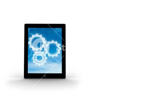 Cogs in clouds on tablet screen
