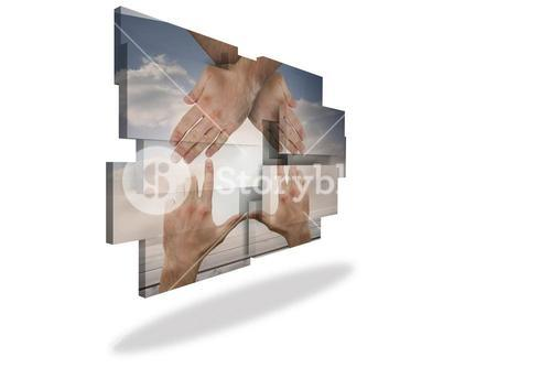 Hands making a house on abstract screen