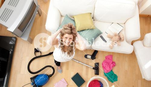 Frustrated blond woman vacuuming the livingroom