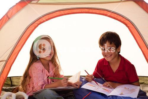 Kids drawing in a tent
