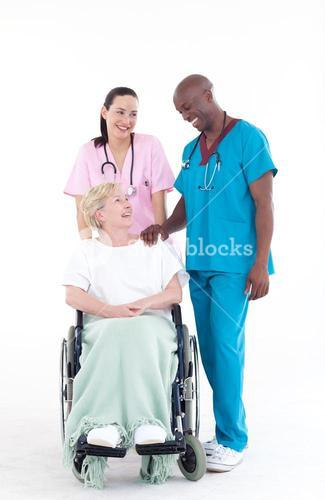 NUrse and doctor with a patient in a wheel chair