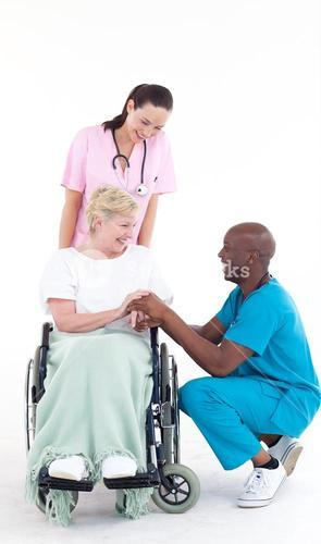 Doctor talking to a senior patient in a wheel chair