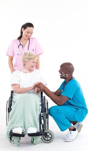 Doctor speaking to a senior patient in a wheel chair