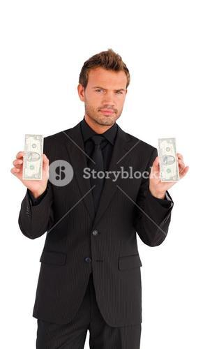 Handsome businessman holding a bundle of money