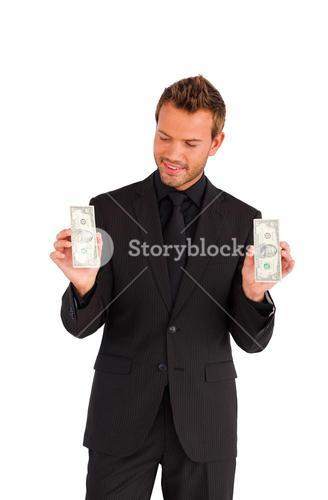 Attractive businessman holding money isolated against white background