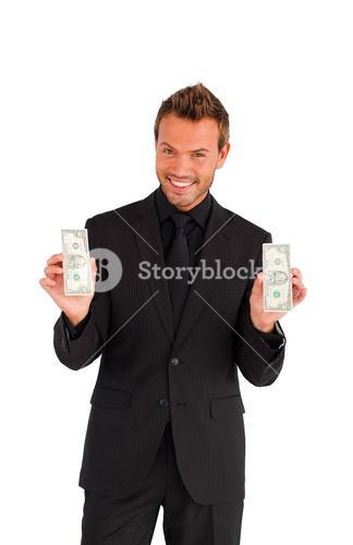 Happy businessman with money looking at the camera