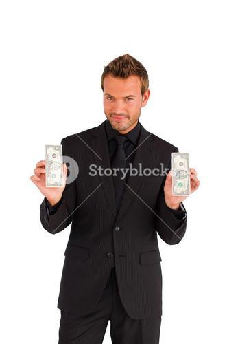 Confident businessman with money looking at the camera