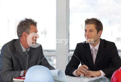 Two business people talking about a report