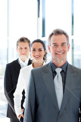 Young businesswoman in focus with her team
