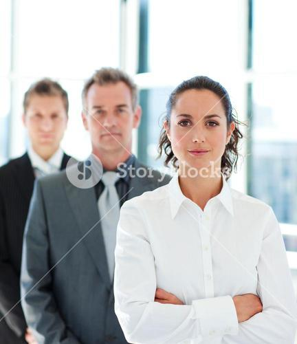 Businesswoman with folded arms in a line
