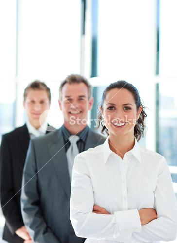 Smiling businesswoman with folded arms in a line
