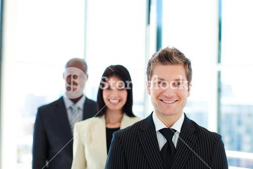Smiling businessman leading his team