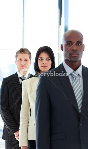 Serious businesswoman in focus with her team