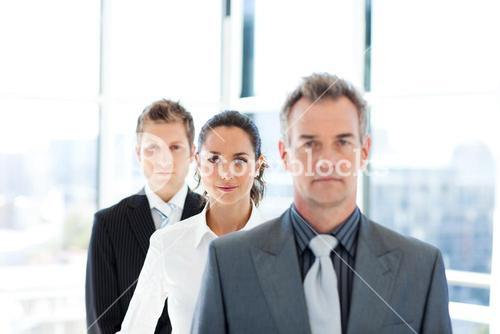 Businesswoman in focus with her team
