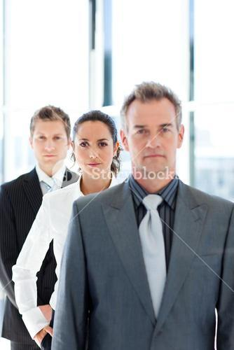 Confident businesswoman in focus with her team