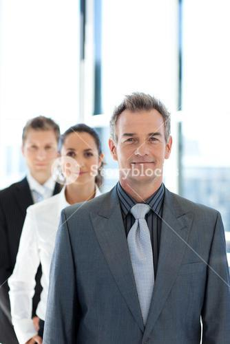 Businessman leading a business team in a line