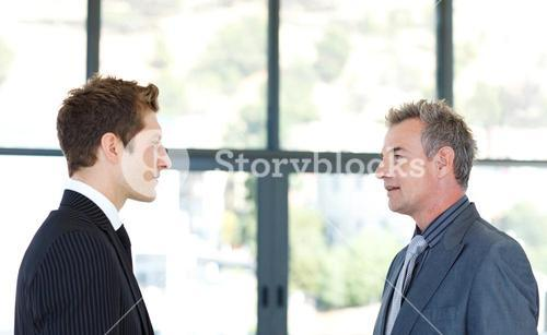 Businessmen talking to each other