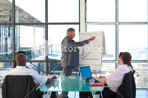 Mature manager in a presentation