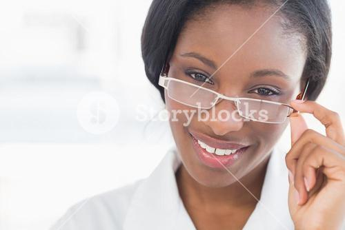 Closeup portrait of a female doctor with eye glasses