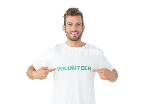 Portrait of a happy male volunteer pointing to himself