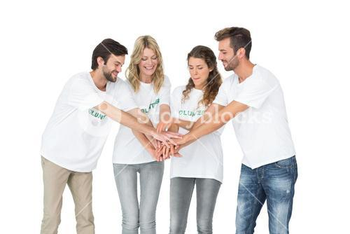 Group of happy volunteers with hands together
