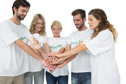 Group of young volunteers with hands together