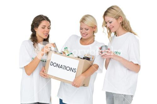Three smiling young women with donation box