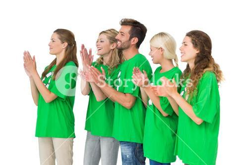 People in recycling symbol tshirts clapping hands