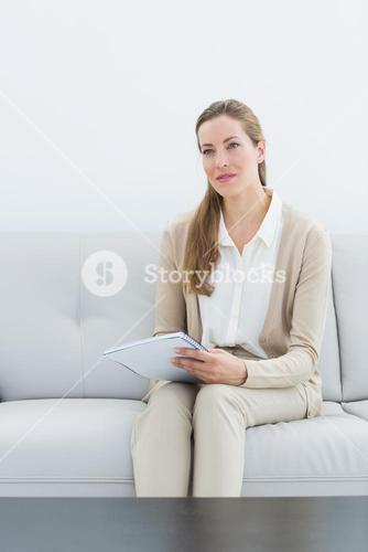 Female psychologist sitting on sofa