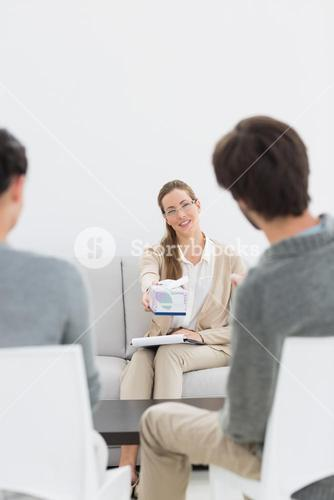Female relationship counselor in meeting with young couple