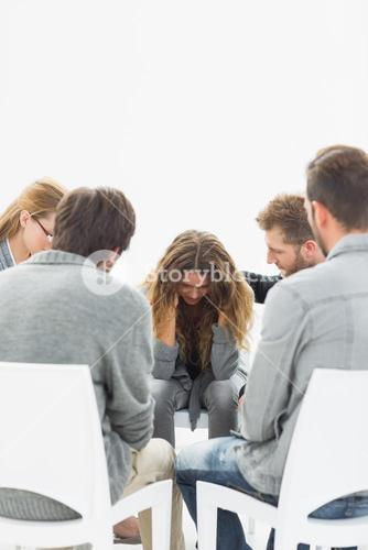 Group therapy in session sitting in a circle