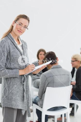 Therapist with group therapy in session