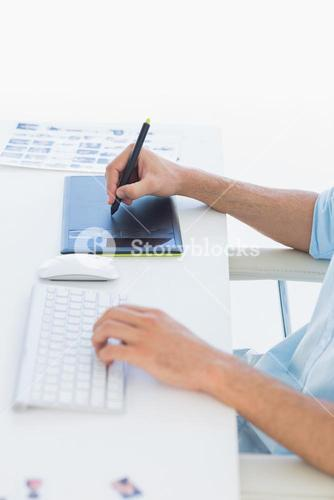 Male photo editor using graphics tablet